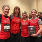 Jeannie (pictured far left) with the TRL's women's 60+ team at the USATF Masters 8km Championships in 2018.
