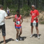 Tim helps Raghav cool down during the 2014 Cascade Lakes Relay