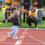 An athlete crosses the finish line at the 2012 Special Olympics Regional Track Meet.
